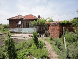 Cheap Bungalow at the outskirts of the village, offering 1000sq.m of land in regulation, Good Condition, Well-developed village, 36km from the SEA!